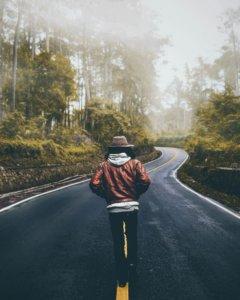 Boy traveling down road